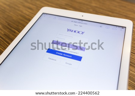 CHIANG MAI, THAILAND - SEPTEMBER 17, 2014: Yahoo.com website page using Apple iPad Air on September 17, 2014 in Chiang Mai, Thailand. - stock photo
