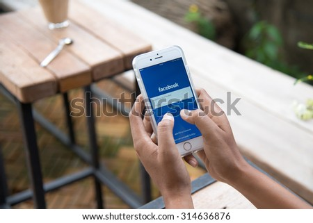 CHIANG MAI ,THAILAND - September 09, 2015: Young man sign in Facebook application  page on Apple iPhone 6. Facebook is largest and most popular social networking site in the world. - stock photo