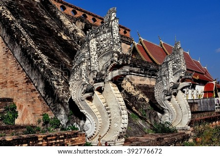 Chiang Mai, Thailand:  Two of the imposing five-headed Naga staircase figures leading up to the 1401 great Chedi at Wat Chedi Luang