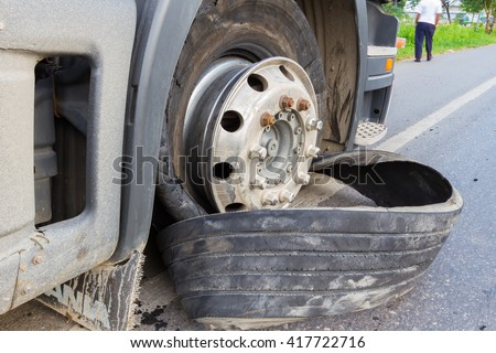 CHIANG RAI, THAILAND - SEPTEMBER 27 : closeup damaged 18 wheeler semi truck burst tires by highway street with unidentified driver standing beside on September 25, 2015 in Chiang rai, Thailand - stock photo