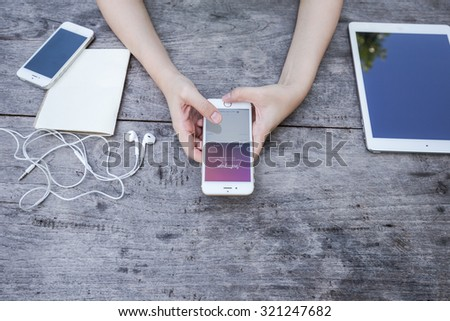 CHIANG RAI, THAILAND - SEPTEMBER 13, 2015: Woman try to log in page Instagram application using Apple iPhone 6. Instagram is largest and most popular photograph social networking site in the world. - stock photo