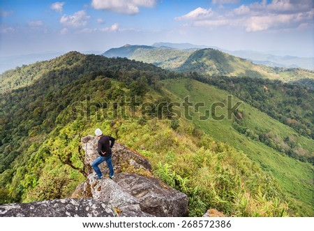 Chiangmai,Amphoe Aomgoi Thailand - December 14, 2013: Tourists stand on the cliff and sightseeing of mountain at the Doi Monjong Mt. in Aomgoi Wildlife Sanctuary