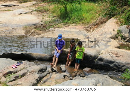 Chiangmai province , Thailand : april 13 , 2016 : Three girls stand in the river