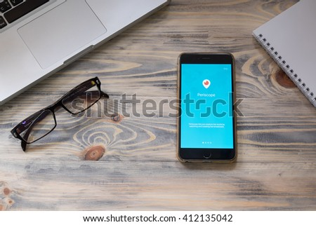 CHIANGMAI ,THAILAND, APRIL 27 2016 :Apple iPhone 6 plus open Periscope app on rustic wood,Periscope is made by Twitter - lets you broadcast live video to the world. - stock photo