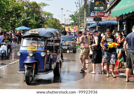 CHIANGMAI THAILAND-APRIL 12:Chiangmai Songkran festival.Tuk-tuk taxis are popular for use in the tourism festival.on April 12,2012 in Chiangmai,Thailand.