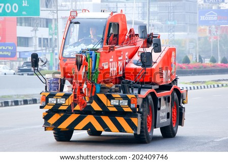 CHIANGMAI , THAILAND - APRIL 20 2014: Crane Truck  of Nim See Seng Transport 1988 company.. Photo at Road No.11 about 2 Km from Chiangmai city.  - stock photo