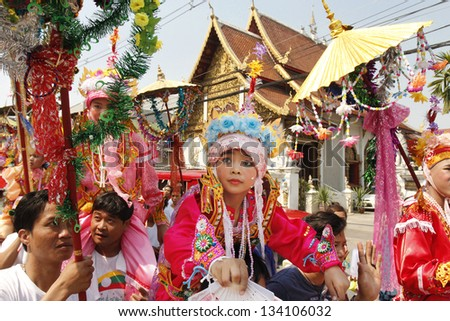 CHIANGMAI, THAILAND-APRIL 5:Poi Sang Long festival, A Ceremony of unidentified boys to become novice monk, during in parade around township on April 5, 2013 in Chiangmai, Thailand.
