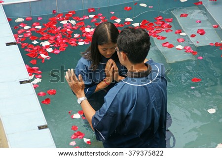 CHIANGMAI, THAILAND - AUGUST 8, 2015 : Ceremony of baptism. Christians make baptism in water pond at Chiangmai Fellowship Church in Chiangmai, Thailand. - stock photo