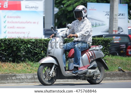 CHIANGMAI, THAILAND -AUGUST 10 2016:  Private Honda Scoopy i Motorcycle.  On road no.1001, 8 km from Chiangmai Business Area.
