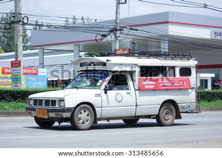 CHIANGMAI, THAILAND -AUGUST 13 2015:  White Pick up truck taxi chiangmai, Service between city and Borsang. Photo at road no.121 about 8 km from downtown Chiangmai, thailand.