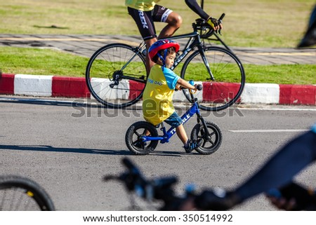 CHIANGMAI,THAILAND - DEC 11: Bike for Dad activity in Father Day on December 11th  2015 in Chiangmai.Thai people ride bicycle to celebrate the Father day every year. - stock photo