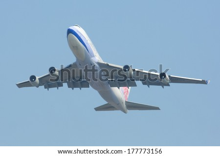 CHIANGMAI ,  THAILAND - DECEMBER  5 2008: B-18206 Boeing 747-400 of  China airline. Take off from Chiangmai airport to taipei. - stock photo
