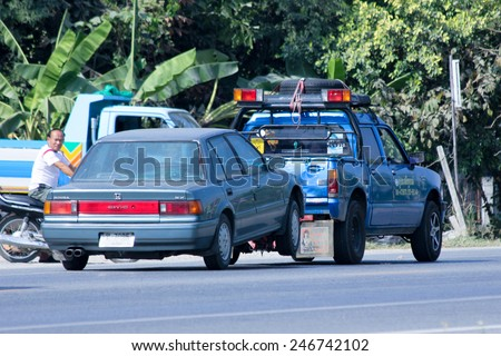 CHIANGMAI , THAILAND - DECEMBER 9 2014:  Prasert Yorn Tow truck for emergency car move. Photo at road no 121 about 8 km from downtown Chiangmai, thailand. - stock photo