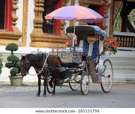 CHIANGMAI, THAILAND- FEBRUARY 11 2015: Horse carriage at White Triangle Pagoda, Wat Chedi Liam, Wiang Kum Kam. Service for Tourist around Wiang Kumkam, Chiangmai Thailand.