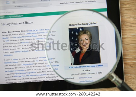 CHIANGMAI, THAILAND - February 26, 2015: Photo of Wikipedia article page about Hillary Rodham Clinton on a ipad monitor screen through a magnifying glass. - stock photo