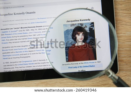 CHIANGMAI, THAILAND - February 26, 2015: Photo of Wikipedia article page about Jacqueline Kennedy Onassis on a ipad monitor screen through a magnifying glass. - stock photo
