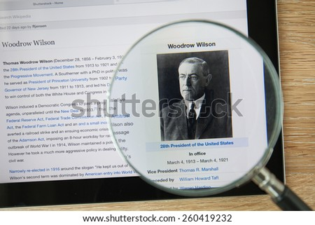 CHIANGMAI, THAILAND - February 26, 2015: Photo of Wikipedia article page about Woodrow Wilson on a ipad monitor screen through a magnifying glass. - stock photo
