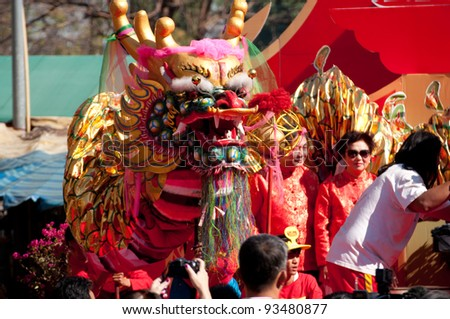 CHIANGMAI THAILAND-JANUARY 23 :Chinese New Year in Thailand. People come to watch the opening ceremony and visit to the Chinese market Warorot. on January 23,2012 in Chiangmai,Thailand. - stock photo