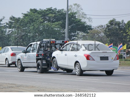 CHIANGMAI, THAILAND -JANUARY 15 2015:  24plus7 Tow truck for emergency car move. Photo at road no 1001 about 8 km from downtown Chiangmai, thailand. - stock photo