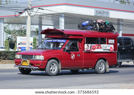CHIANGMAI, THAILAND -JANUARY 8 2016:  Red taxi chiangmai, Service in city and around. Photo at road no.121 about 8 km from downtown Chiangmai, thailand.