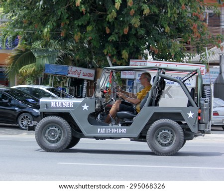 CHIANGMAI, THAILAND -JULY 2 2015: Old Jeep Private car. Photo at road no 1001 about 8 km from downtown Chiangmai, thailand.