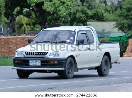 CHIANGMAI, THAILAND -JULY  2 2015: Private car, Mitsubishi Strada. Photo at road no 121 about 8 km from downtown Chiangmai, thailand. - stock photo