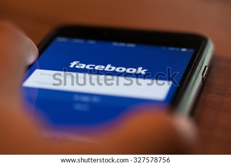 CHIANGMAI, THAILAND -JUNE 26, 2015:Facebook application sign in page on Apple iPad. Facebook is largest and most popular social networking site in the world. - stock photo