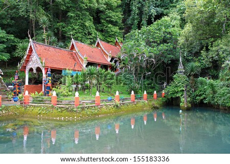 CHIANGMAI, THAILAND - JUNE 2012 : Main entrance at Chiangdao Cave surrounded by green fish pond at Doi Chung mountain on June 16, 2012 in Chiangmai. One of popular tourist attractions in Thailand