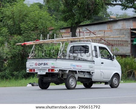 CHIANGMAI, THAILAND -JUNE 25 2015:  Pickup truck of True company. Intenet Service in Thailand. Photo at road no 121 about 8 km from downtown Chiangmai, thailand. - stock photo