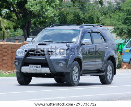 CHIANGMAI, THAILAND -JUNE 30 2015: Private car, Toyota Fortuner. Photo at road no 121 about 8 km from downtown Chiangmai, thailand.  - stock photo