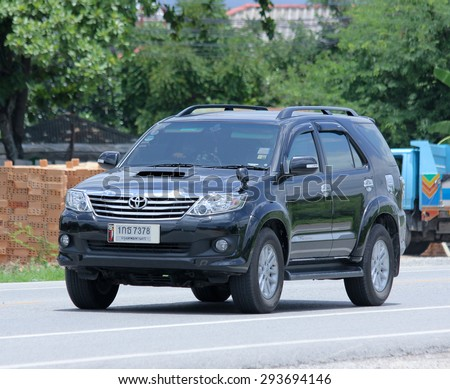 CHIANGMAI, THAILAND -JUNE 30 2015:   Private car, Toyota Fortuner suv for city user. Photo at road no 121 about 8 km from downtown Chiangmai, thailand. - stock photo