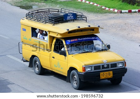 CHIANGMAI, THAILAND - JUNE 4 2014 : Yellow  mini truck taxi chiangmai, Service between city and maetang district. Photo at road no 107, About 8 Km from chiangmai city, thailand.