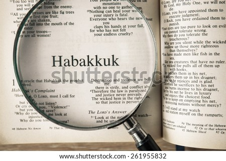 "CHIANGMAI, THAILAND, March 17,2015. Reading The New International Version of the Holy Bible on the book of "" habakkuk "" at home. March 17,2015"