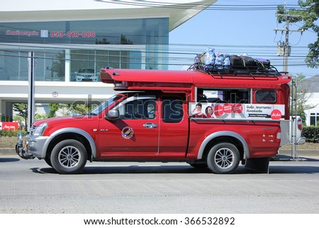 CHIANGMAI, THAILAND -NOVEMBER 21 2015:   Red taxi chiangmai, Service in city and around. Photo at road no.121 about 8 km from downtown Chiangmai, thailand.