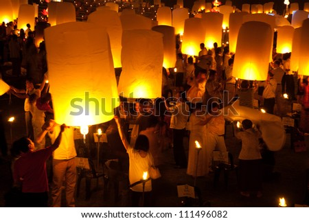 CHIANGMAI, THAILAND - NOVEMBER 8 :Thai people floating lamp. November 8 ,2011 in Tudongkasatarn, Chiangmai, Thailand. Tudongkasatarn is where floating lamp ceremony takes place every year.