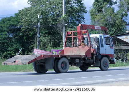 CHIANGMAI, THAILAND -OCTOBER 25 2014: Private Truck with crane. Photo at road no.121 about 8 km from downtown Chiangmai, thailand.