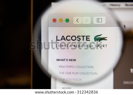 CHIANGMAI, THAILAND - September 1, 2015: Photo of Lacoste homepage on a monitor screen through a magnifying glass.