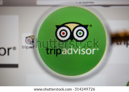 CHIANGMAI, THAILAND - September 1, 2015:TripAdvisor homepage through a magnifying glass.TripAdvisor.com is a travel website providing directory information and reviews of travel-related content.