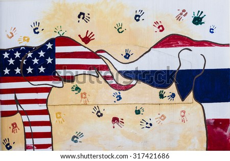 CHIANGMAI, THAILAND - September 11, 2015. wall painted show elephants with Thailand, USA. Flag at U.S. Consulate General office wall in occasion of 180 years U.S.-THAI RELATIONS by consulate community