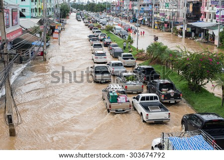 CHIANGRAI, THAILAND 6 AUGUST 2015, Flooding in Chiangrai in front of MAE FAH LUANG UNIVERSITY, bad traffic (high iso)