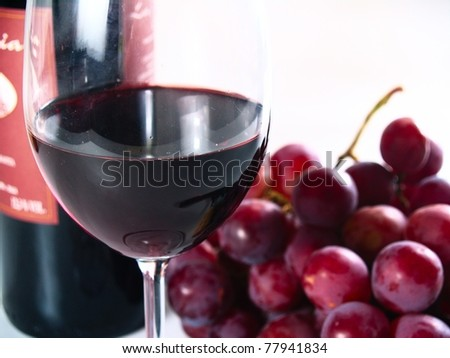 chianti reserve red wine, glass, grapes - stock photo