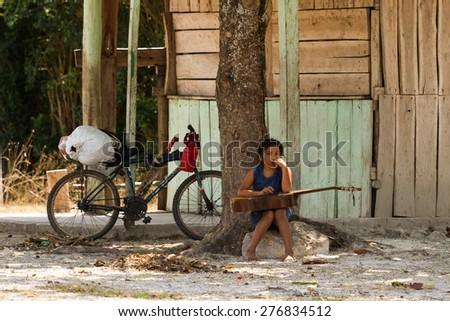 Chiapas, Mexico: 25 March, 2015. Girl with guitar in Chiapas, Mexico  - stock photo