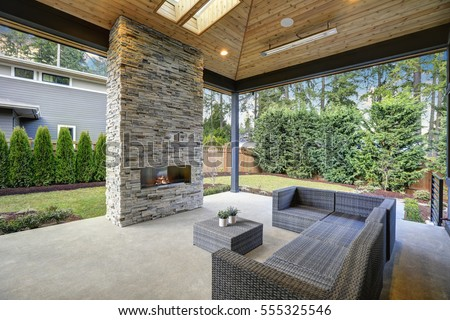 Chic, Elegant Deck Patio Design Features Vaulted Paneled Ceiling With  Skylights Over A Floor To