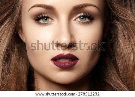 Chic evening style. Alluring woman model with luxury fashion make-up, dark red lips makeup and long hair. Trends colors, marsala wine color lipstick, strong eyebrows, sexy hair - stock photo