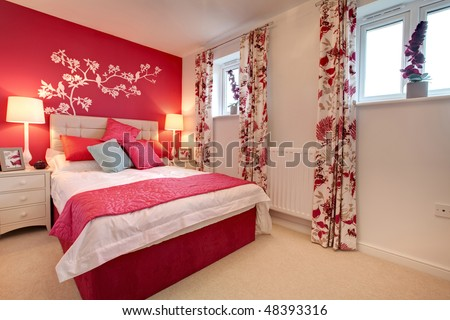 Chic modern bedroom decorated in bright colors with mural - stock photo
