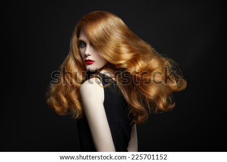 Chic woman with red hair on black background - stock photo