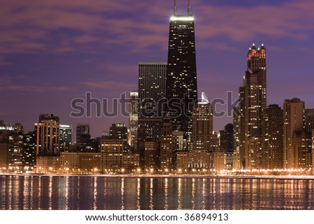 Chicago across the lake - sunset time. - stock photo