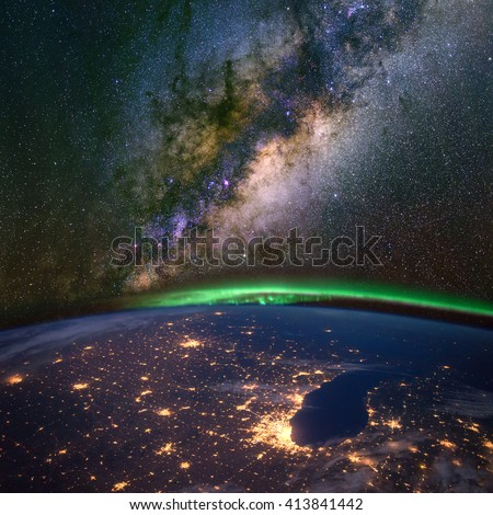Chicago and lake Michigan from space at night, with the aurora Borealis and the Milky Way. Elements of this image furnished by NASA.  - stock photo