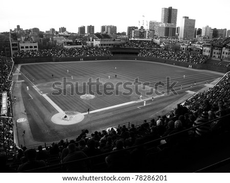 CHICAGO - APRIL 26: Historic Wrigley Field during a game pitting the Cubs against the Washington Nationals on April 26, 2010 in Chicago, Illinois. In black and white. - stock photo