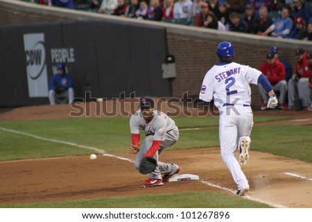 CHICAGO - APRIL 25: Ian Stewart of the Chicago Cubs runs to first base against the St. Louis Cardinals at Wrigley Field on April 25, 2012 in Chicago, Illinois. - stock photo